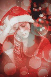 vrouw met kerstmuts baalt