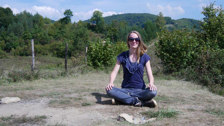 Femke de gray meditates on top of Tumulus